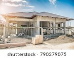 construction residential new house in progress at building site - stock photo