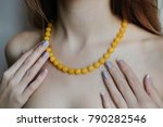 necklace of yellow beads on the ... | Shutterstock . vector #790282546