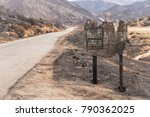 Destroyed Wooden Sign Along...