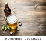 glass of beer with stoppers and ... | Shutterstock . vector #790436338