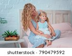 mom and daughter are sitting on ... | Shutterstock . vector #790479592