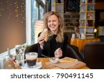 a young blonde girl eats a... | Shutterstock . vector #790491145
