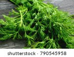 Fresh Dill On Wooden Background....