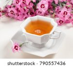Cup Of Green Tea On White Tabl...