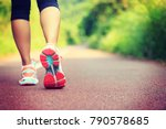 Stock photo young fitness female runner legs ready for run on forest trail 790578685