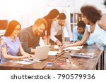 a group of young people work in ... | Shutterstock . vector #790579936