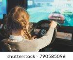 little girl playing racing... | Shutterstock . vector #790585096