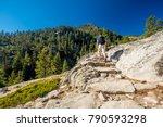 tourist with backpack hiking in ... | Shutterstock . vector #790593298