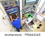 man assembles electronic...   Shutterstock . vector #790663165