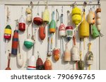 Colorful Buoys Hanged On Woode...