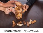 teamwork join to stack wood for ... | Shutterstock . vector #790696966
