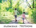 children walk on a forest road. ...   Shutterstock . vector #790704346