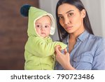 portrait of young mother with... | Shutterstock . vector #790723486
