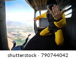 parachuting on sunny day | Shutterstock . vector #790744042