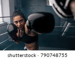 Boxer Practicing Her Punches A...