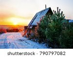A Small Wooden House With Fenc...