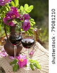 Romantic lunch setting with wine and rose - stock photo