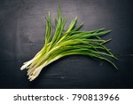 fresh green onion on a wooden...