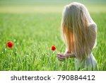 beautiful girl on green field... | Shutterstock . vector #790884412