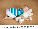 baby sleeping on wooden floor... | Shutterstock . vector #790912696