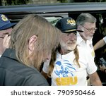 Small photo of Washington, DC. USA, 31st August, 1991 AFL-CIO President Lane Kirkland gets together with Country Music artist WIllie Nelson during the AFL-CIO Rally and concert in downtown DC.