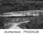 frozen river in winter | Shutterstock . vector #791024128