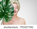 happy girl with a towel on her... | Shutterstock . vector #791027782