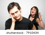 Small photo of arguing couple - young woman shouting at her shirty husband