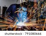 welder is welding metal part in ... | Shutterstock . vector #791080666