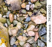 Small photo of travel in France - granite pebble on beach of Gouffre gulf of English Channel near Plougrescant town of the Cotes-d'Armor department in Brittany in summer