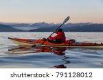 adventure man on a sea kayak is ...   Shutterstock . vector #791128012