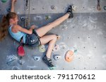 teen girl climbing a rock wall... | Shutterstock . vector #791170612