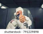 painter spray gun in the hands... | Shutterstock . vector #791229898