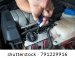 screwdriver in the hands of an... | Shutterstock . vector #791229916