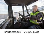 worker driving towing truck on... | Shutterstock . vector #791231635