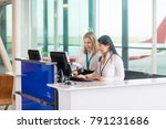 receptionists using computer at ... | Shutterstock . vector #791231686