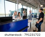 staff using computer while... | Shutterstock . vector #791231722