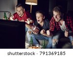 excited men supporting their... | Shutterstock . vector #791369185
