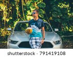 young man standing by the ford... | Shutterstock . vector #791419108