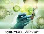 A Scientist Holding A Petri...