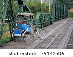Tricycle in hitorical bridge - stock photo
