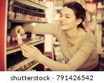 smiling woman customer deciding ... | Shutterstock . vector #791426542