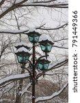 Snow Coverd On Streetlight In...