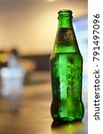 Small photo of Penang, Malaysia - May 13, 2014: A classic bottle of Sprite being serve by the waiter with caps already opened