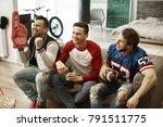 men watching match at living... | Shutterstock . vector #791511775