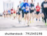 marathon runners in the city  | Shutterstock . vector #791545198