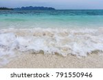 crashing wave and white sand... | Shutterstock . vector #791550946
