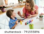 happy young mother and son are... | Shutterstock . vector #791555896