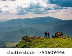 tourists stand on cliff... | Shutterstock . vector #791609446