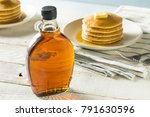 raw organic amber maple syrup... | Shutterstock . vector #791630596